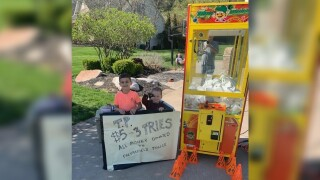 Boys set up claw machine filled with toilet paper to support police during pandemic