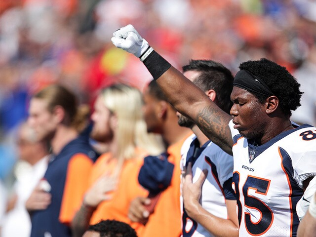 In photos: Broncos kneel, lock arms and raise fists after Trump's remarks