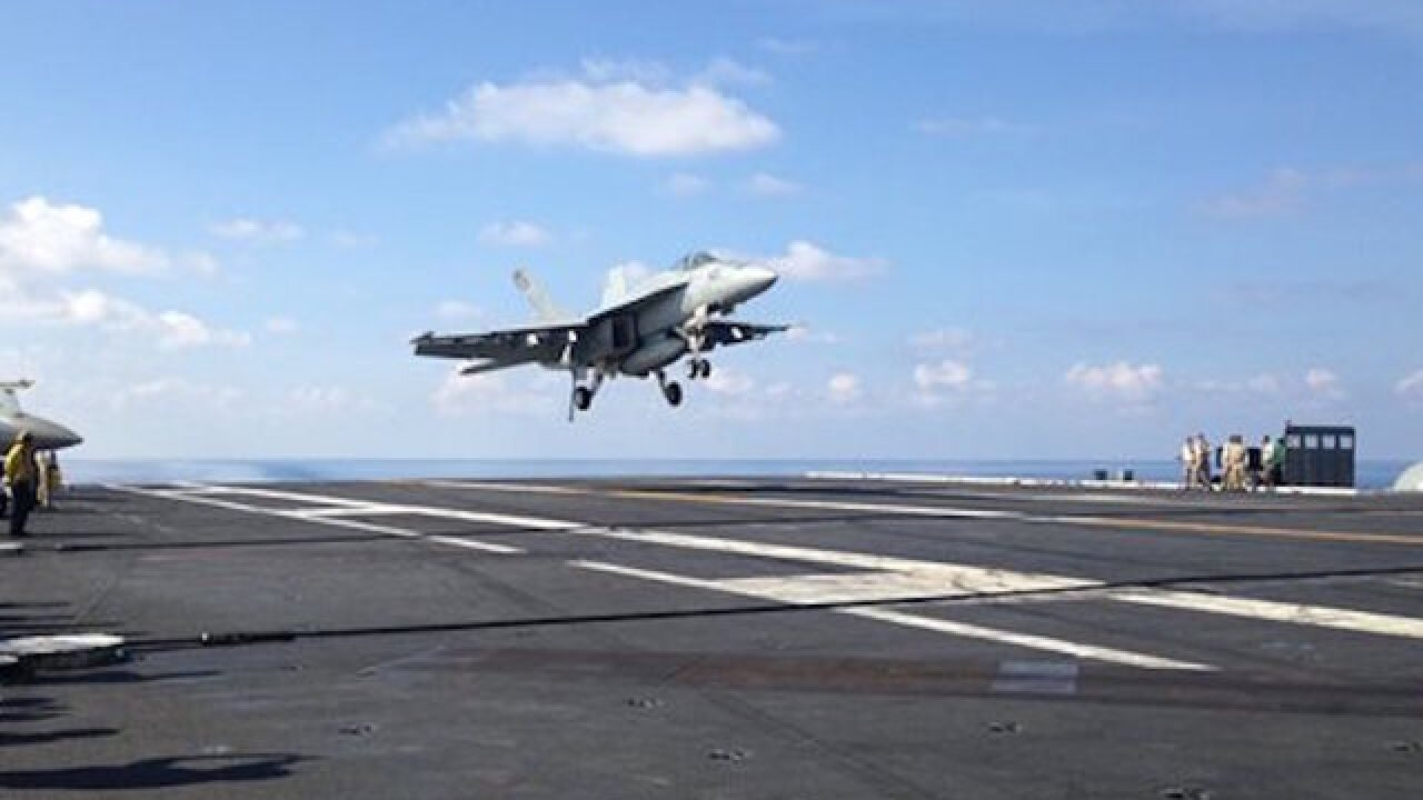 Carter visits US carrier in South China Sea