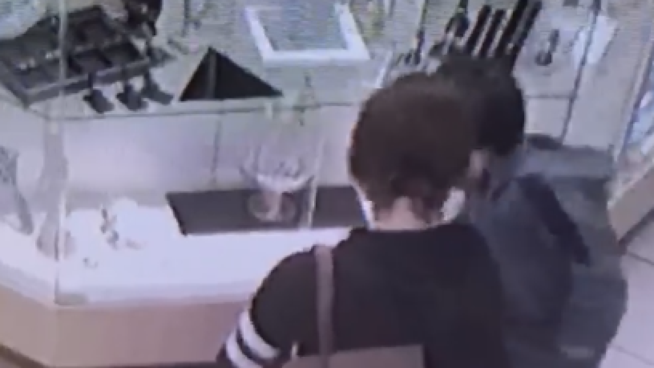 woman in pawn shop.PNG