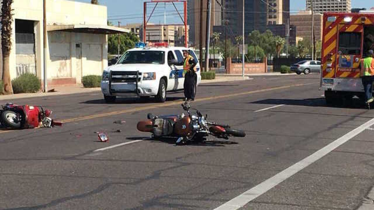 Two motorcyclists seriously injured after colliding with car in Phoenix, police say