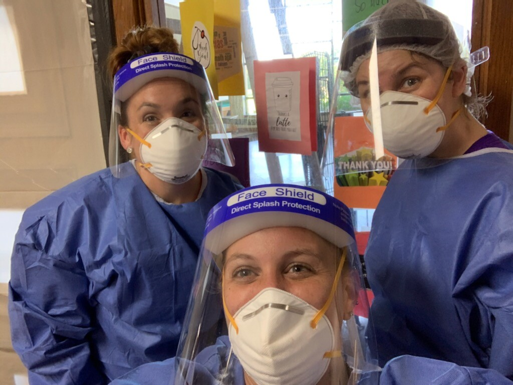 Long-term care COVID nurses in full PPE