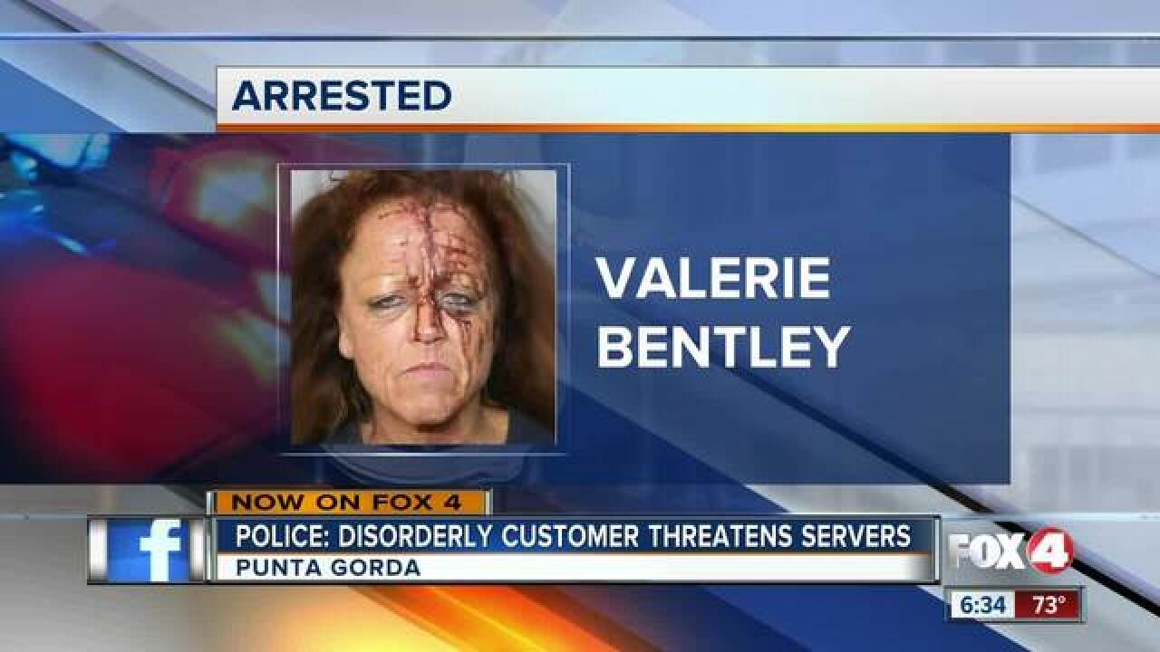 Woman's violent outburst leads to bloody mugshot