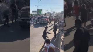 Driver goes through crowd of protesters