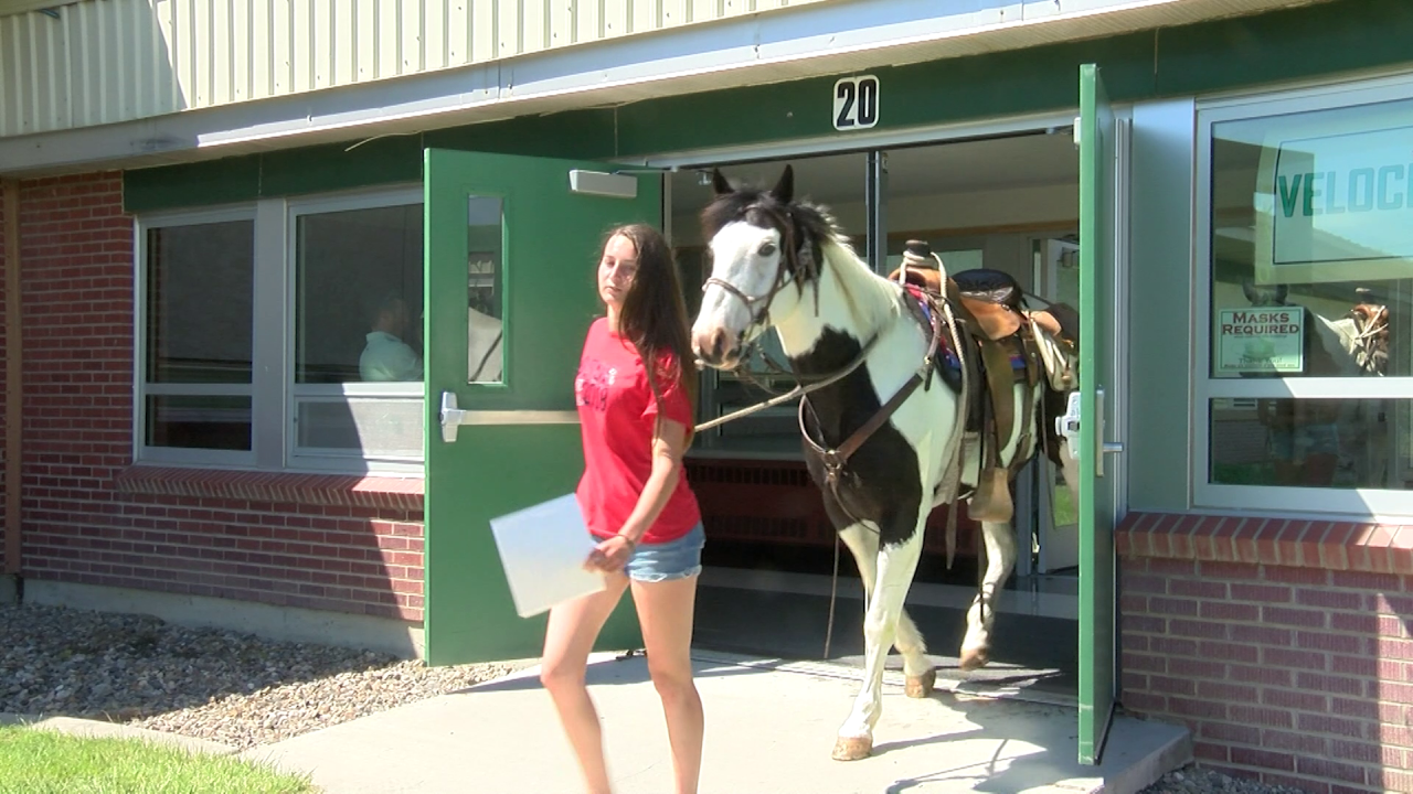 East Middle School students ride horses to school