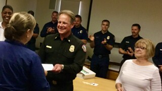Montecito Fire Chief Kevin Taylor presents CERT Student with Completion Certificate 11919.jpeg