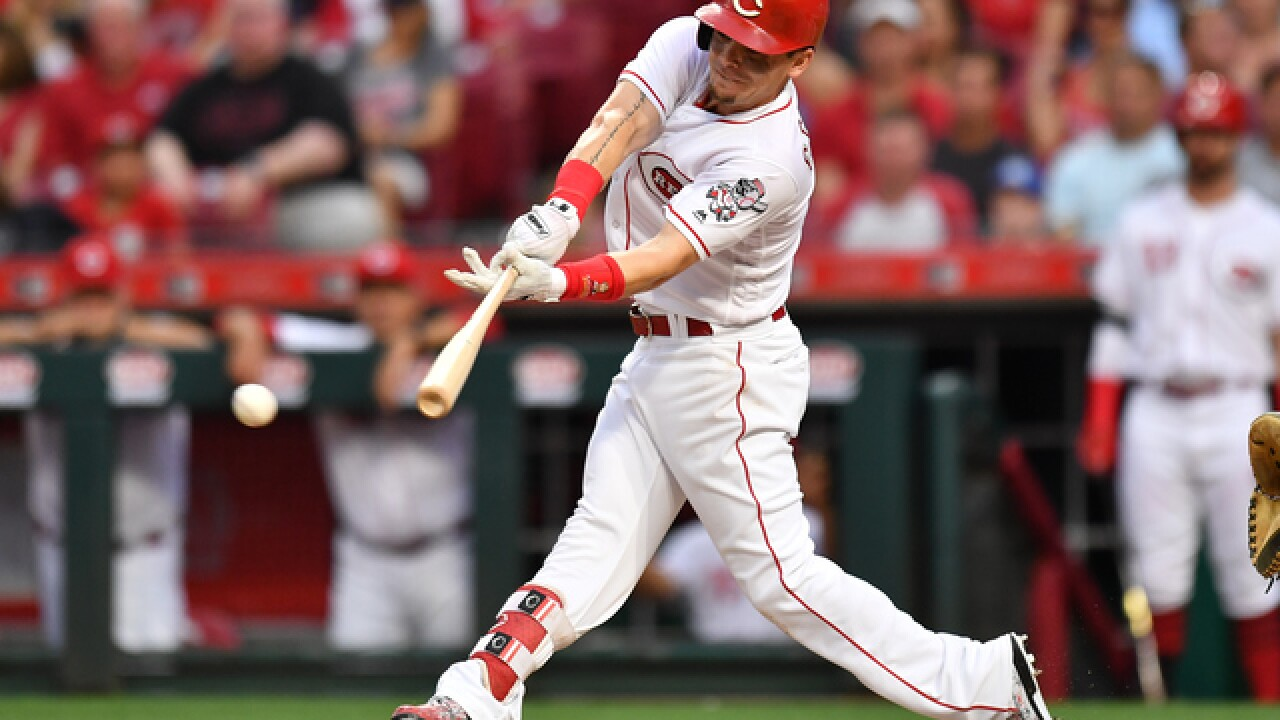 Scooter Gennett, Eugenio Suarez homers rally Reds over Tigers