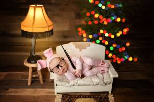 Newborn poses with BB gun replica in 'A Christmas Story' photo shoot