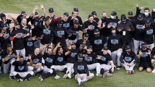 Miami Marlins celebrate after beating Chicago Cubs, Oct. 2, 2020