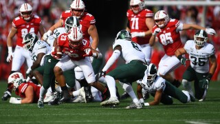 Jonathan Taylor, No. 8 Wisconsin rout Michigan State