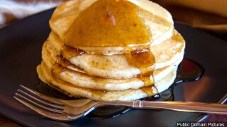 Syrup being drizzled onto stack of pancakes.jpg