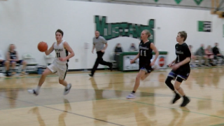 Ennis' Ian Swanson breaks past two Sheridan defenders, finishes with a team-high 24 points
