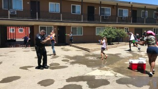 Police wage water fight with kids whose apartment pool is closed due to COVID-19