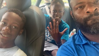 Pierre-Richard Victor, who's going back to school with help from the VA's Veteran Employment and Readiness Program, pictured with his two boys.