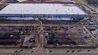 Aerial photographs show the progress of Amazon fulfillment center at former North Randall Park mall