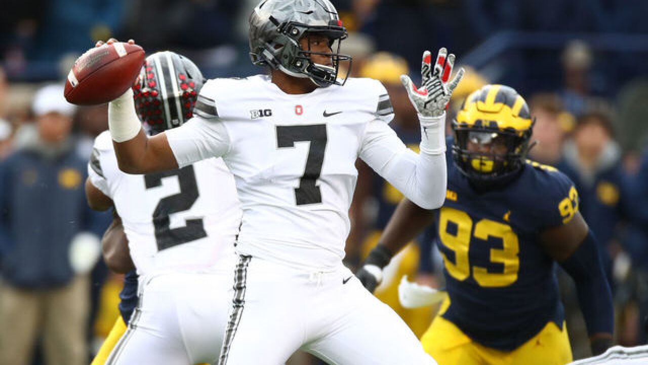Haskins helps No. 8 Ohio State rally to beat Michigan 31-20