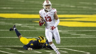 No. 13 Wisconsin returns from COVID-19 hiatus, routs Michigan