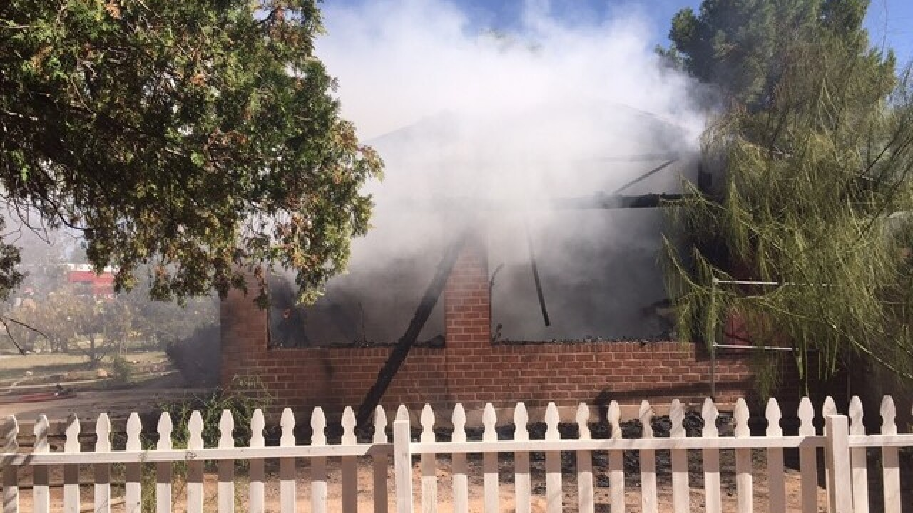 Tucson Fire working to put out carport fire