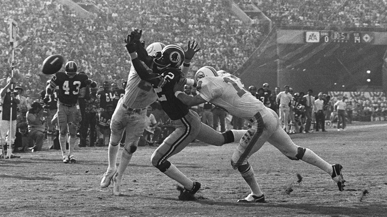 Miami Dolphins safety Jake Scott breaks up pass in Super Bowl VII