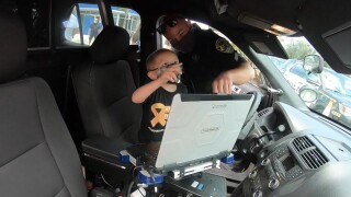 Cancer patient Kaine Meisle, 4, spends the day with Boynton Beach police on April 30, 2021.jpg