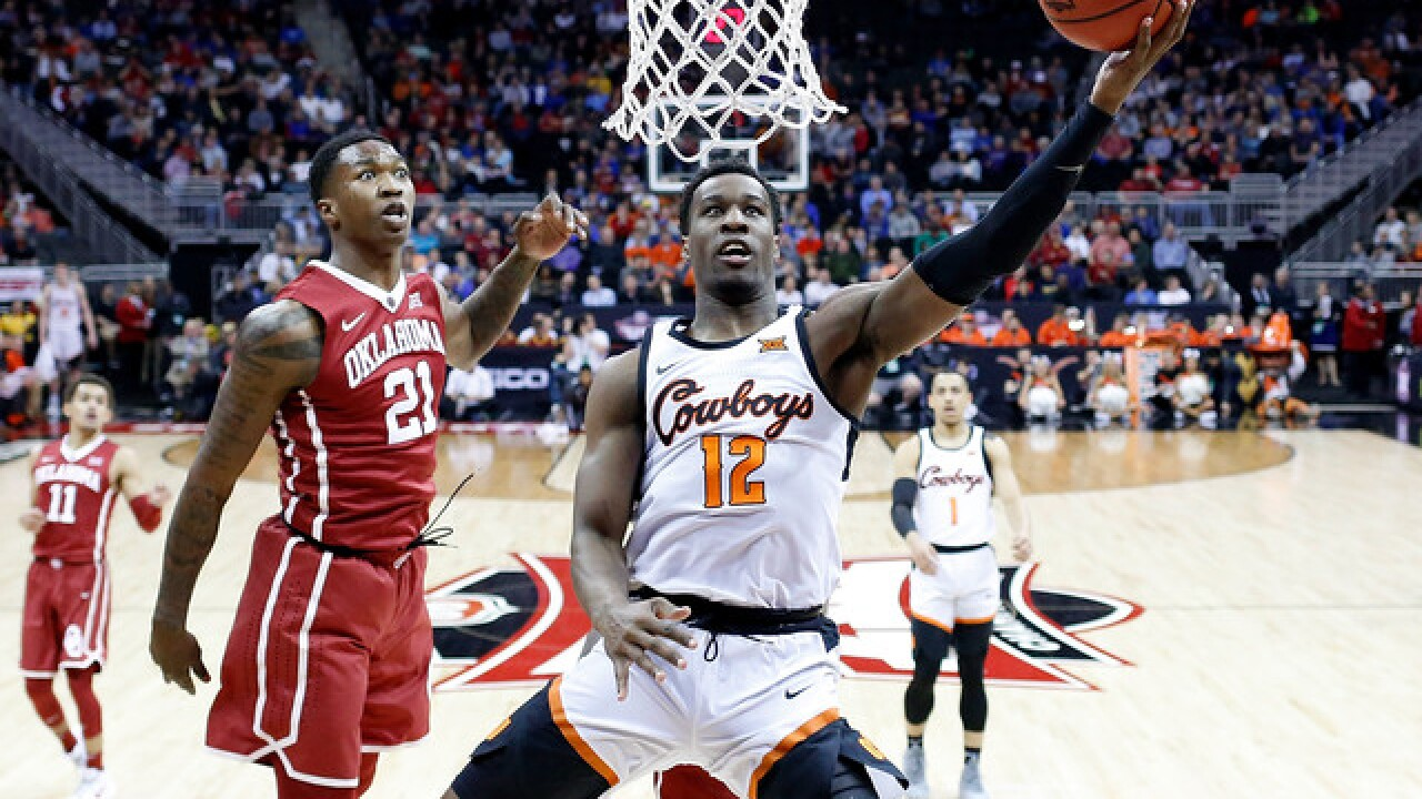 Bedlam in KC!; Pokes never trail in eliminating Oklahoma 71-60 at Big 12 Championship