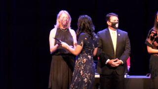 teachers accepting an award