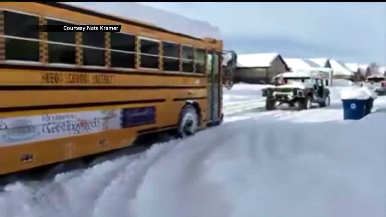 Good Samaritans in Humvee rescue school bus stuck insnow