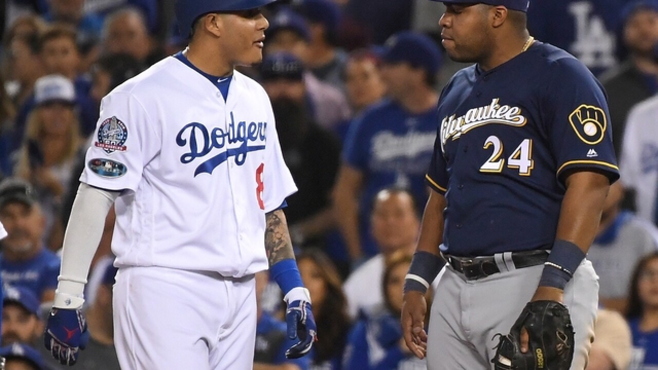 Report: Manny Machado fined for clipping Jesus Aguilar's leg in NLCS Game 4