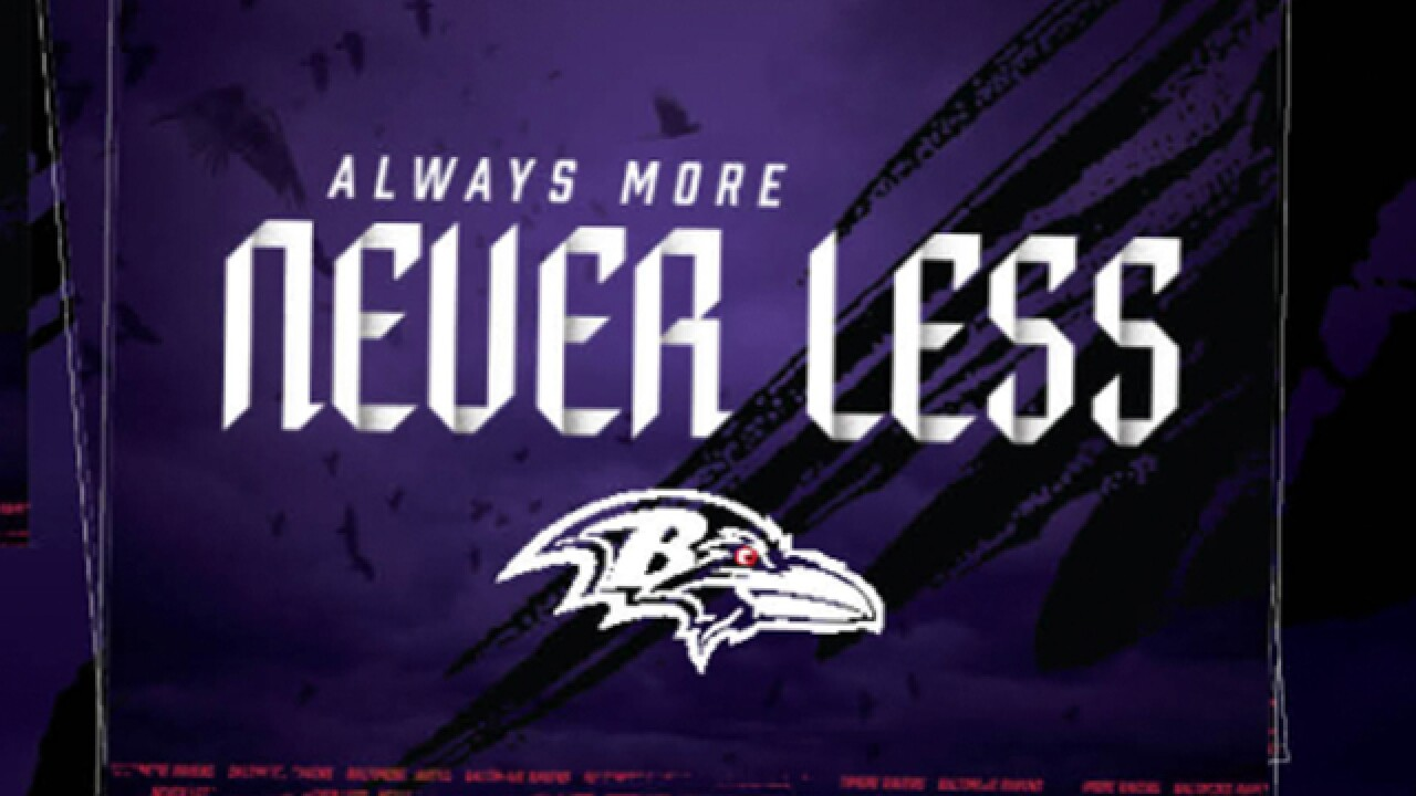 Let's paint the town purple! Ravens handing out free signs to kick off season