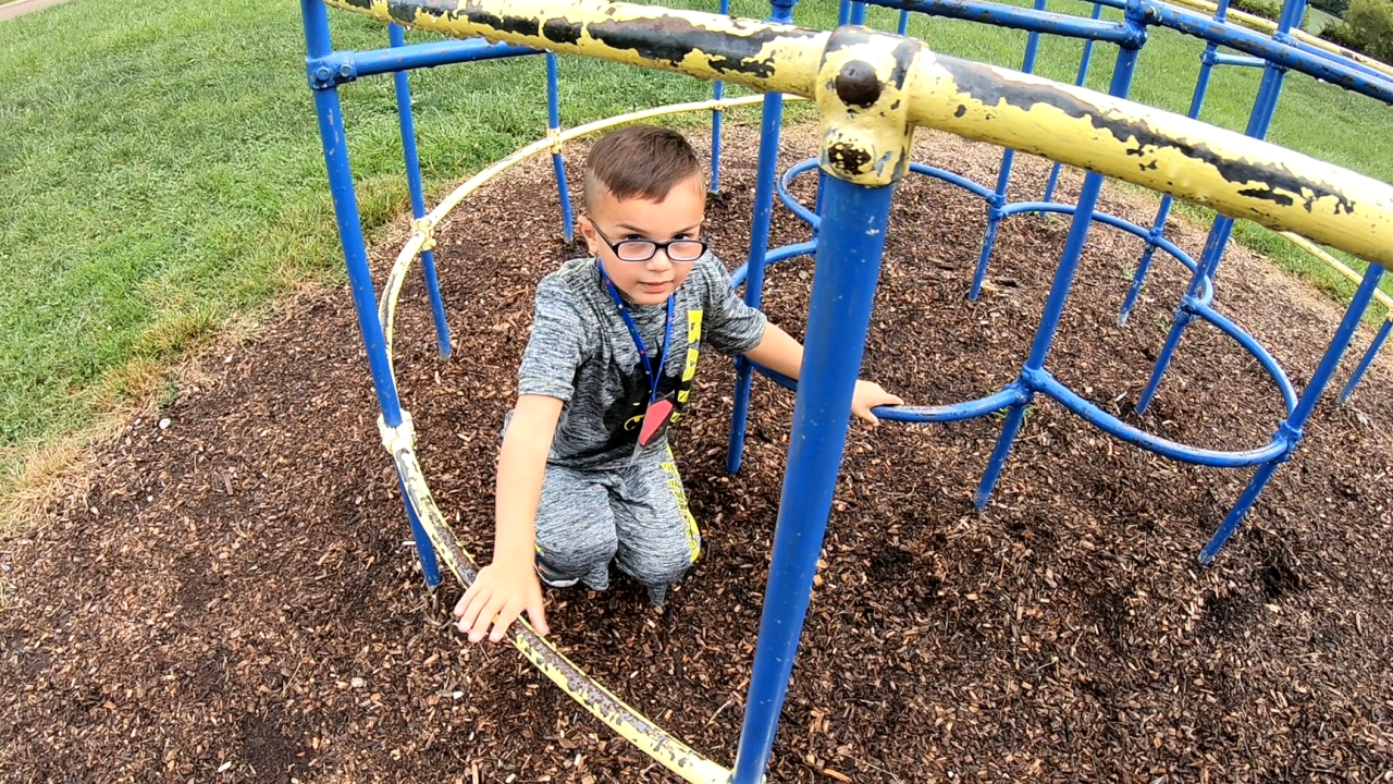 5-year old Alexander Campbell plays on equipment at Crosby Elementary in Harrison, Ohio