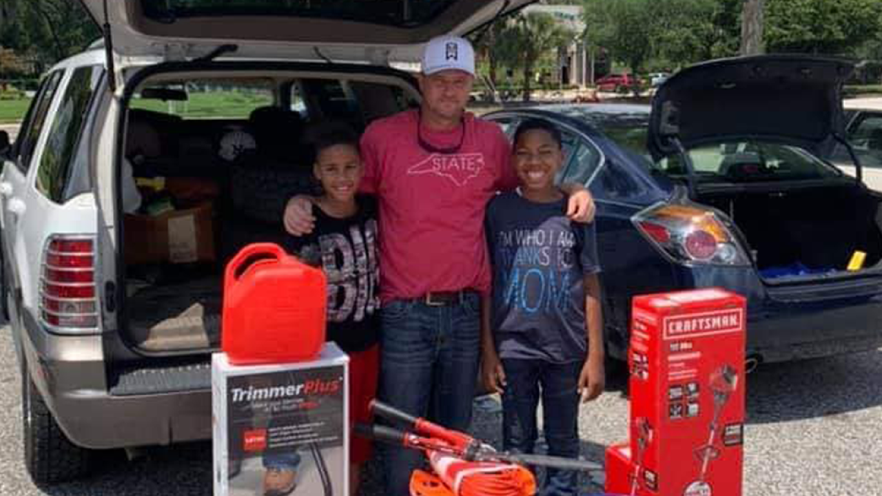 11-year-old Florida boys trying to start lawn care business surprised by stranger with equipment