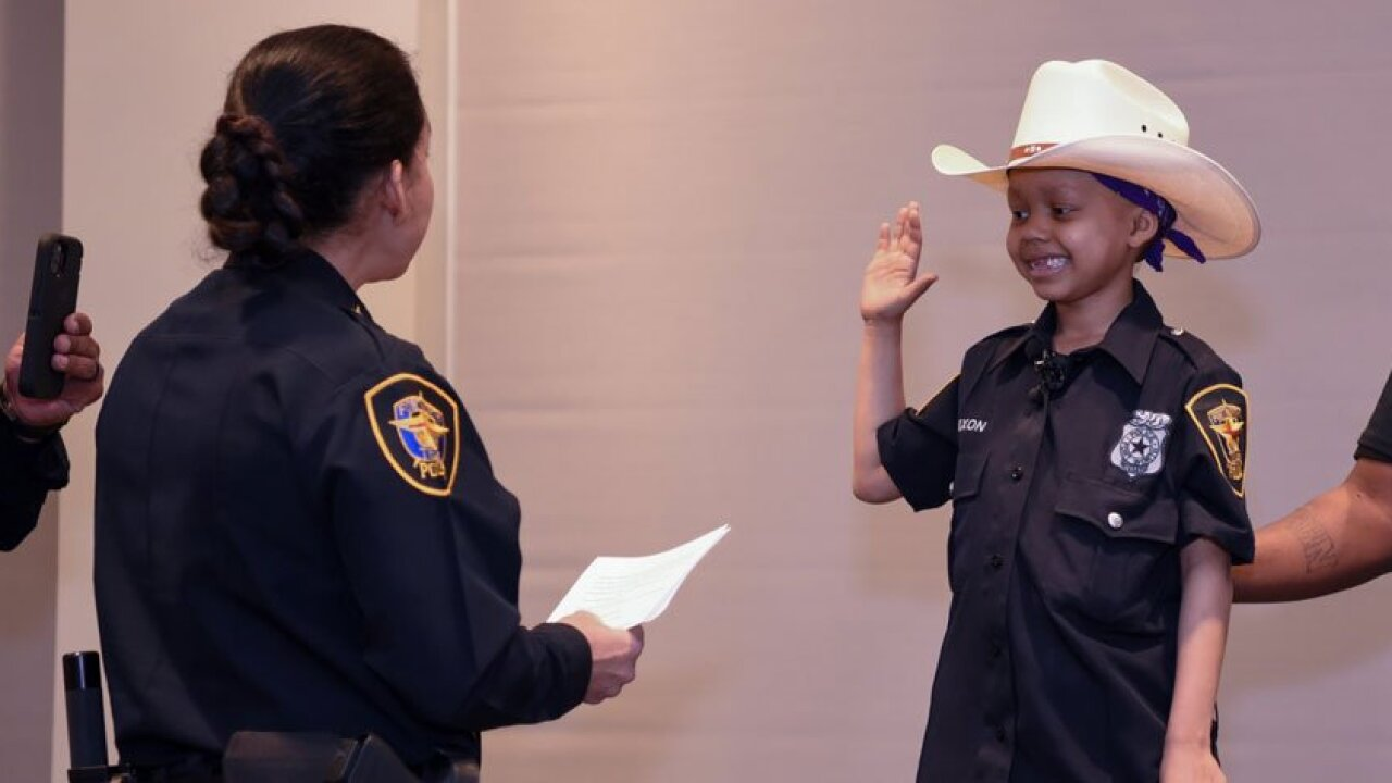Child with rare form of liver cancer becomes honorary Fort Worth Police officer