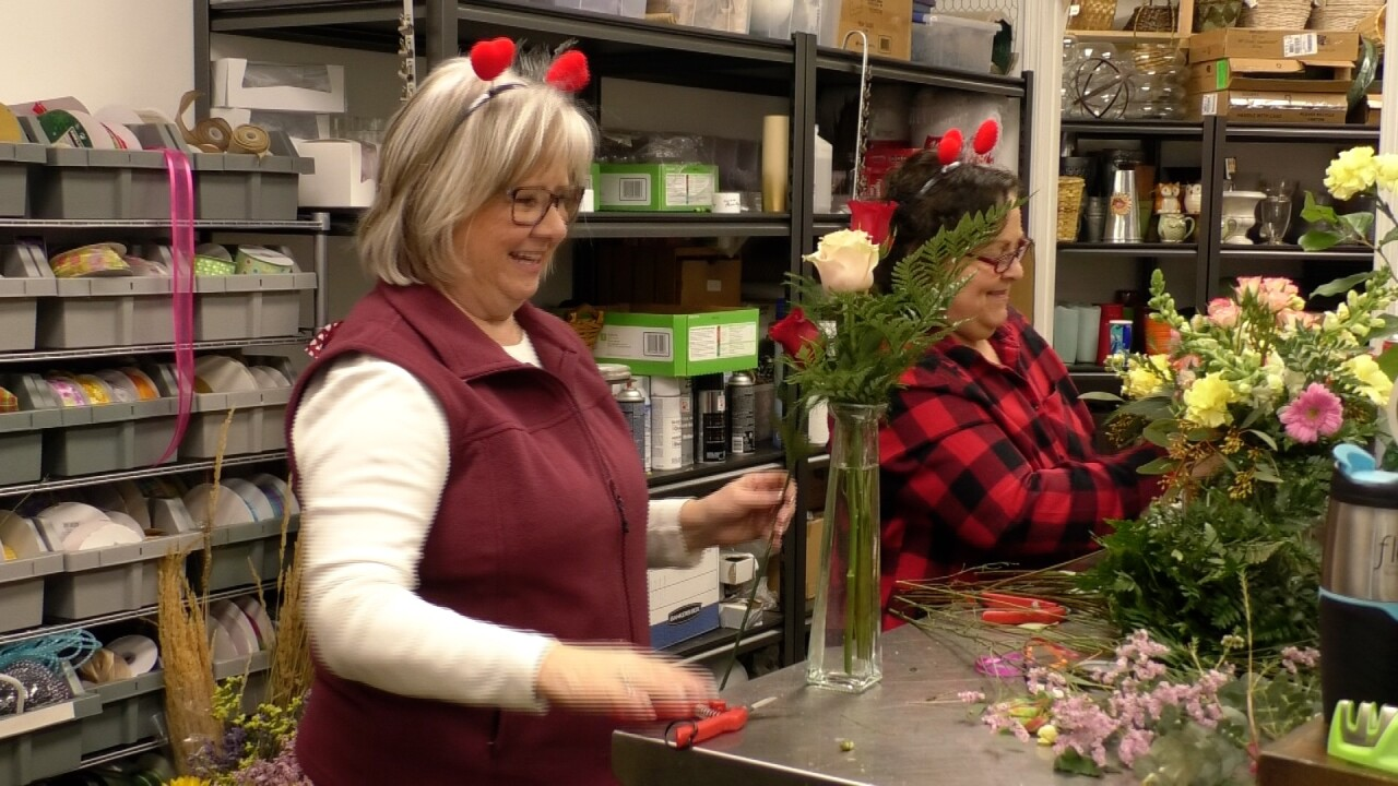 The ladies at Budget Bouquets work around the clock to make sure all Valentine's Day orders are complete.