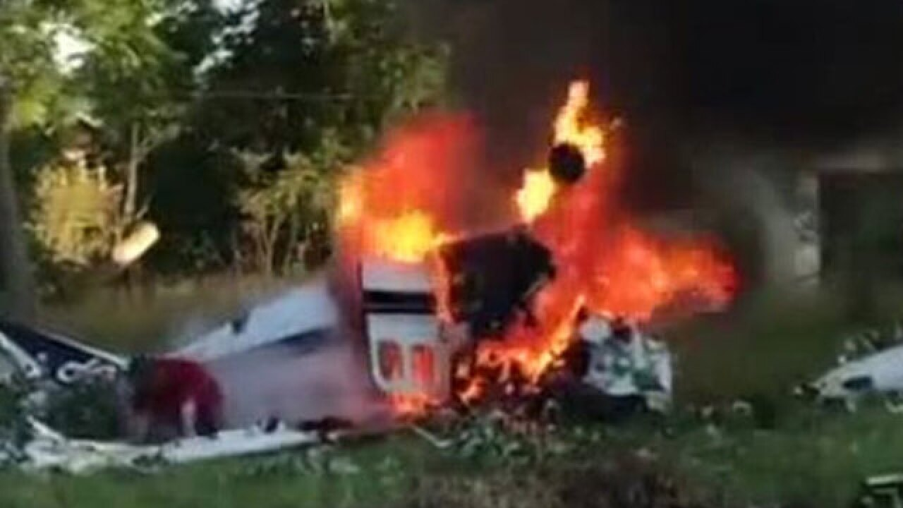Video shows man crawling out of burning plane in Michigan