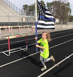 Photos: 8-year-old runs in half marathon in support of wounded Portsmouth officer