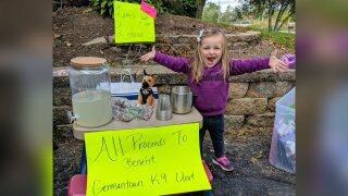 Lainie Stephens, 3, raised $754 for her local police department's K9 unit.