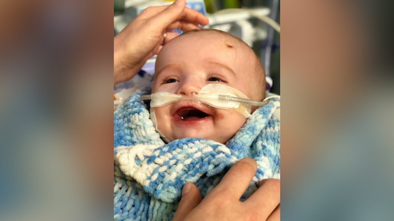 A baby woke up from a coma and smiled at his dad; Now his family is raising money to save his life