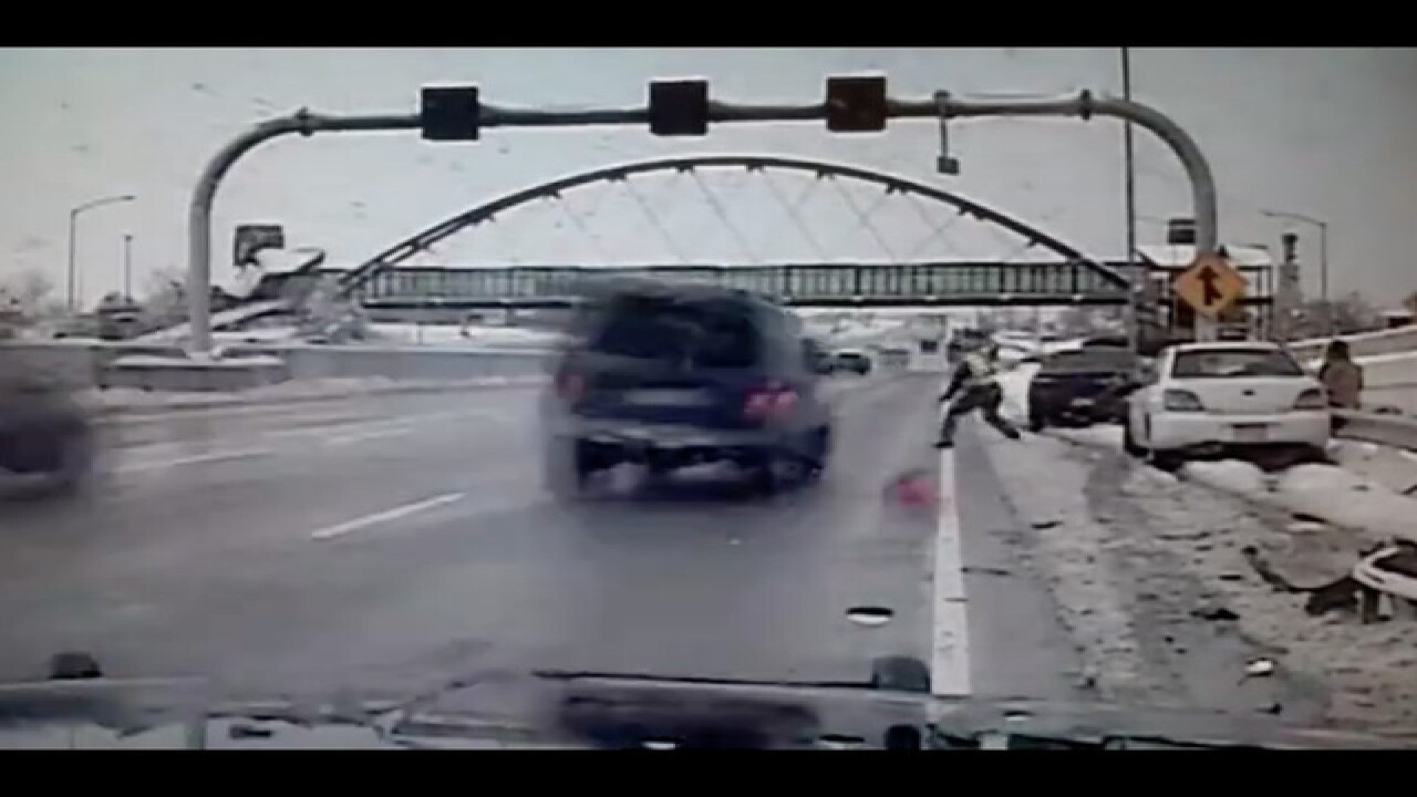 VIDEO: Colorado State Patrol trooper nearly hit by driver while investigating crash