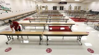 Virus Outbreak Texas Schools