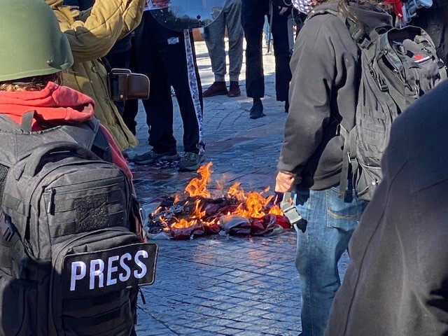 Protesters burn American flag
