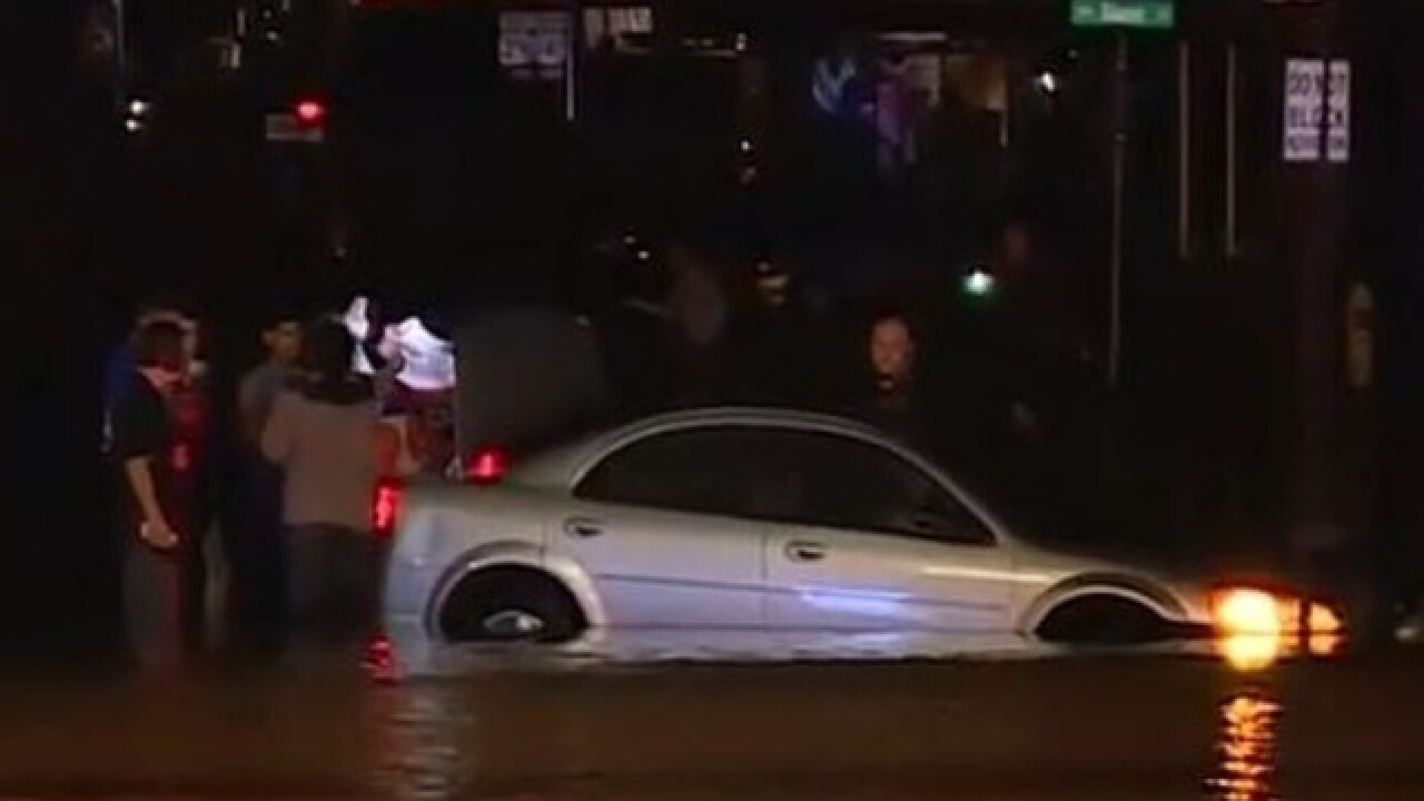 Heavy rain floods streets, damages cars and businesses
