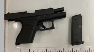This handgun and loaded magazine were detected by TSA officers in a passenger's carry-on bag at General Mitchell International Airport on Sept. 15. (TSA photo