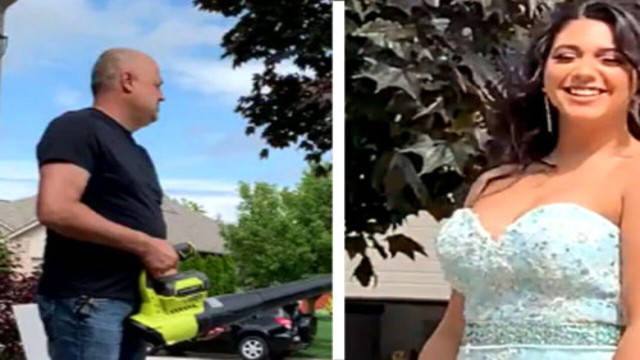 This Adorable Dad Used A Genius Trick To Help His Daughter Get The Perfect Prom Photos