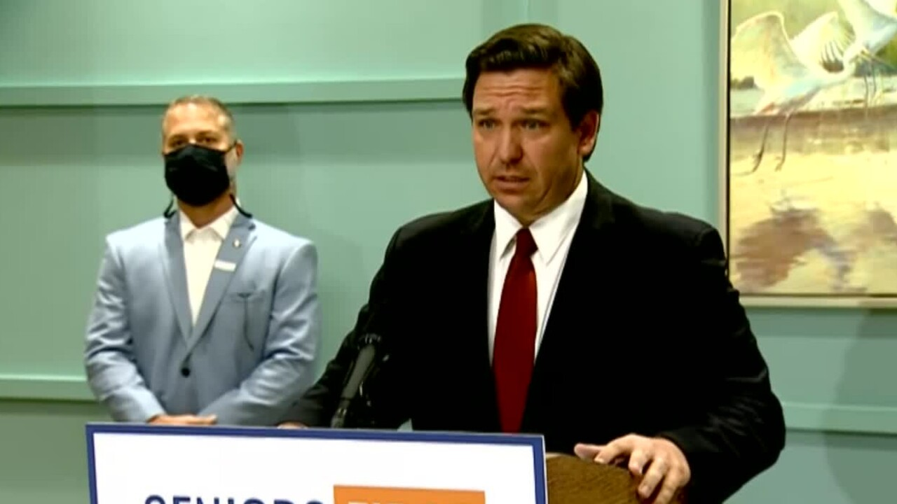 Florida Gov. Ron DeSantis provides an update on the state's response to the COVID-19 pandemic during a news conference in The Villages on Feb. 1, 2021.jpg