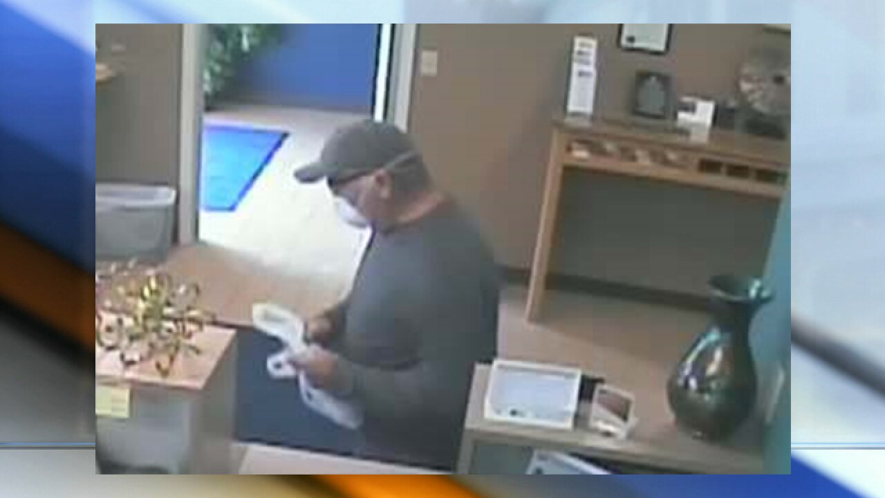 Man in dust mask robs Cass County bank