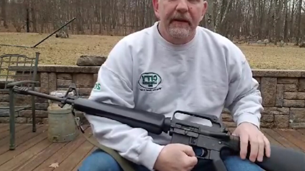 Viral video shows gun owner sawing AR-15 rifle in half