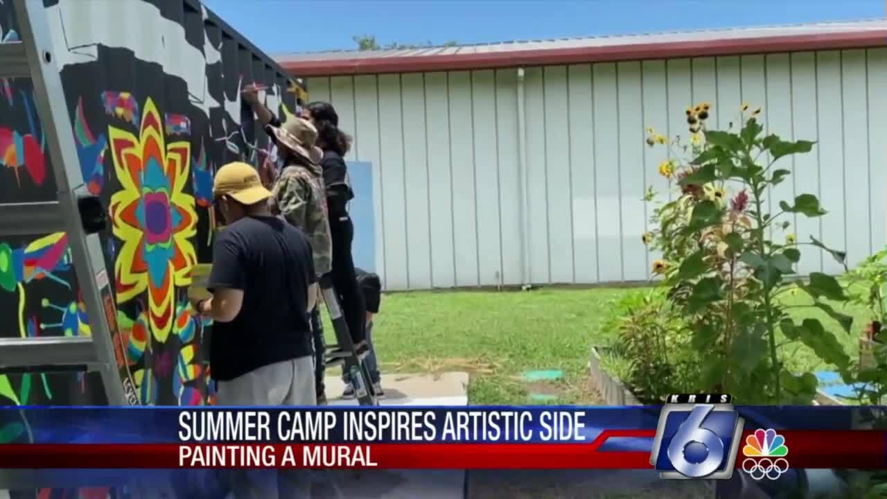 Summer campers producing mural
