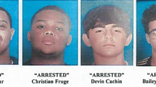 Three arrested in burglary; another sought