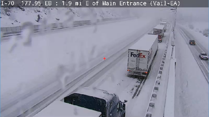 Stopped semis on I-70 at Vail Pass