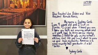 Sydney Carlo with letter to Joe Biden and Kamala Harris